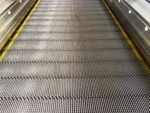 Smooth escalator for Shopping cart in the mall or Airport.  royalty free stock photos