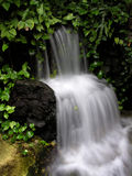 Smooth Fall. A small smooth waterfall Royalty Free Stock Photos