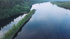 Smooth flight over the river with the island-a dividing ridge. Svir, Karelia, Russia stock footage