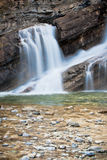 Smooth Flowing Waterfall. A smooth flowing waterfall in Waterton National Park of Alberta Royalty Free Stock Photos