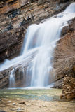 Smooth Flowing Waterfall. A smooth flowing waterfall in Waterton National Park of Alberta Stock Images