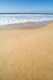 Smooth golden beach sand Stock Images