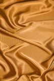 Smooth golden satin Stock Photo