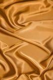 Smooth golden satin Stock Photo