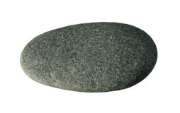 Smooth gray pebble. Smooth flat gray pebble isolated on white background Royalty Free Stock Image