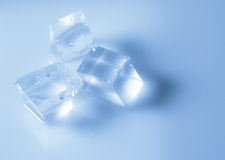 Ice cubes. On cyan background -must for summer Royalty Free Stock Photography