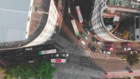 Smooth lift drone above the intersection with the camera down. Traffic at dawn long shadows stock video