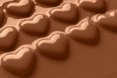 Smooth melted Chocolate hearts Royalty Free Stock Image