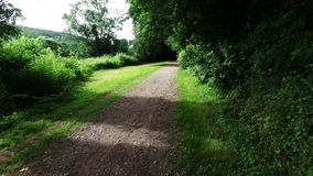 Smooth motion along an english countryside walkway and bridlepath. Smooth motion along an English countryside walkway and bridle path in the summer stock video