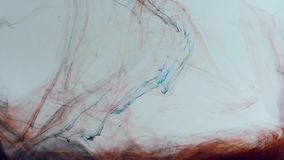 Smooth movement of mixed red and blue paint on a white background. Color haze abstraction stock video footage