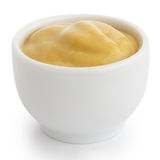 Smooth mustard in white ceramic ramekin. White background Royalty Free Stock Image