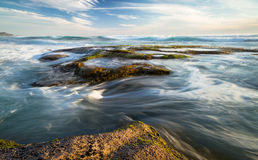 Smooth Ocean Scenery. This long exposure shot just before sunset shows Johanna Beach, near the Cape Otway National Park in Victoria, Australia, at sunset, with Royalty Free Stock Image