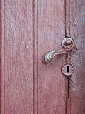 Old wooden door with handle, Lithuania Royalty Free Stock Photo