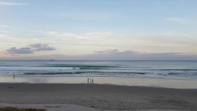 Smooth panning of new zealand beach at Tauranga stock video footage