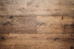 Smooth parquet laminate brown. Laminate flooring planks floor brown Royalty Free Stock Images