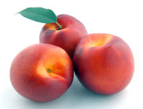 Smooth peach with leaves Royalty Free Stock Image
