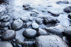 Smooth pebble stones beach Stock Photo