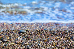 Smooth pebble under water Royalty Free Stock Photos