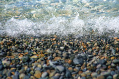Smooth pebble under water. On the river bank Stock Photo