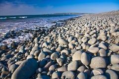 Smooth pebbles. Washed smooth pebbles on beach along devon coastline Stock Image