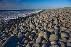 Smooth pebbles. Washed smooth pebbles on beach along devon coastline Stock Photo