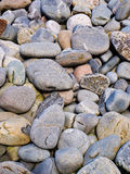 Smooth pebbles. Piles of smooth gray pebbles Stock Photo