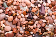 Smooth pink stones. Smooth, pink stones or pebbles, suitable for an abstract background Stock Images