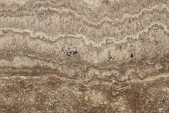 Smooth polished travertine surface - varieties of marble Travertino Classico beige with marble texture on stone.  Royalty Free Stock Photos