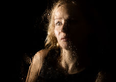Smooth portrait of sexy model, posing behind transparent glass covered by water drops. young melancholy and sad woman Royalty Free Stock Images