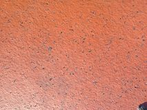 Smooth red brick texture. Photo of a red brick that was in a sidewalk Royalty Free Stock Photo