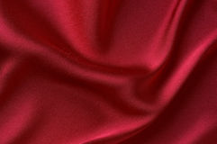 Smooth red satin. As background Royalty Free Stock Photos
