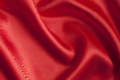 Smooth red satin  background Royalty Free Stock Images