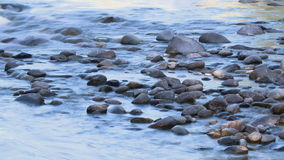 Smooth river rocks timelapse stock video