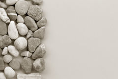 Smooth river stone on gray background Royalty Free Stock Photos