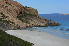 Smooth Rock Coastline of Australia. Large Rocky coastline with serene deep blue sea and sandy beach greenery australia esperance Royalty Free Stock Images