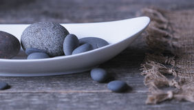 Smooth rocks in long dish Stock Image