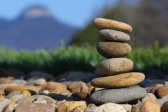 Smooth rocks stacked and balancing stock photo