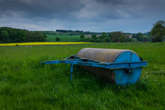 Smooth roller in s field in the sunlight Royalty Free Stock Photo
