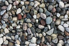 Smooth round colored water stones. Smooth round grey brown water stones different patterns sizes shapes Stock Image