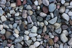 Smooth round grey colored water stones. Smooth round grey brown water stones different sizes shapes textures Royalty Free Stock Photography