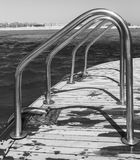 Smooth row Metallic chrome-plated Handrails, railing on a yacht. Against the background of a sunny bright sky, black and white photography royalty free stock photography