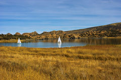 Smooth Sailing Ahead. Two sailboats on a small lake in Arizona Stock Image