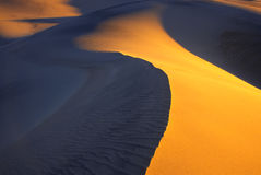 Smooth sand dunes at sunset Royalty Free Stock Photo