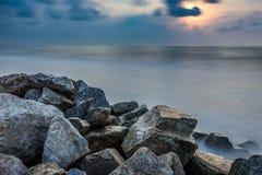 Smooth sea beach and Rocks Royalty Free Stock Photos