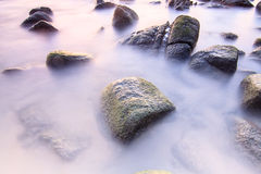 Smooth sea on the stone. At phuket thailand royalty free stock photo
