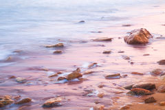 Smooth Sea and Stones on Sunrise Stock Photos