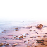 Smooth Sea and Stones on Sunrise  - with white area Royalty Free Stock Photos