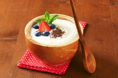 Smooth semolina porridge with fresh fruit and chocolate Royalty Free Stock Photography