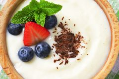 Smooth semolina porridge with fresh fruit and chocolate Stock Photography