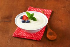 Smooth semolina porridge with fresh fruit Royalty Free Stock Image